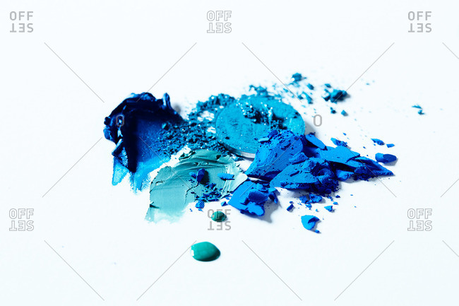 Smeared blue eye shadow on white surface