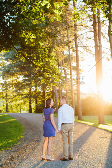 Romantic couple on a path at sunset