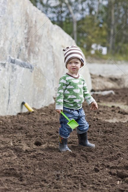 Boy digging in soil