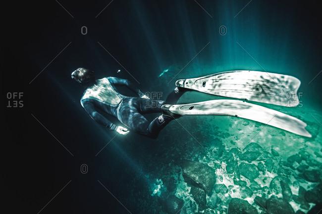 Man free diving near ocean floor
