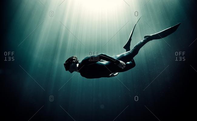 Man free diving underwater
