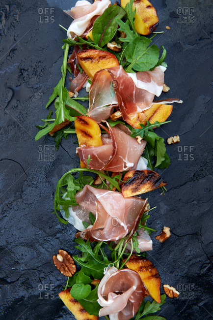Arugula with grilled peaches and prosciutto