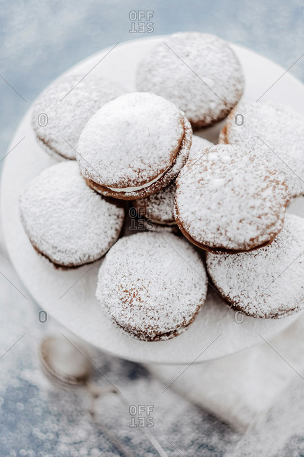 Cream-filled sandwich pastries dusted with powdered sugar