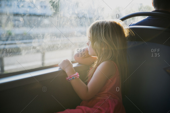 Girl looking out the window of a bus in Italy