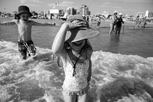 Kids playing in the water in Rimini, Italy