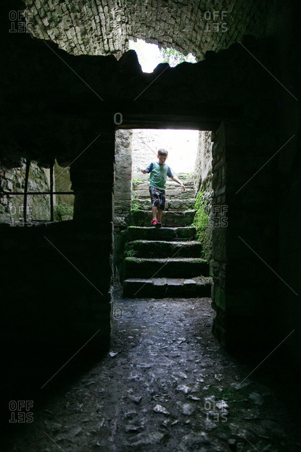 Boy exploring an old building