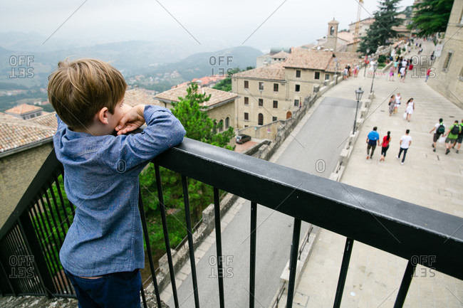 Boy watching the crowds in San Marino, Italy