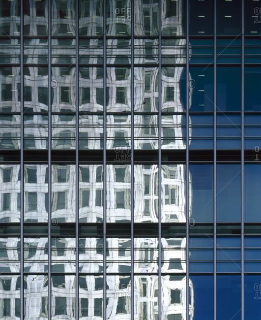 Reflection of a building in a glass facade