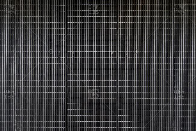 Melbourne, Australia - August 12, 2015: Metal grid facade of RMIT Design Hub, Royal Melbourne Institute of Technology, in Melbourne, Australia