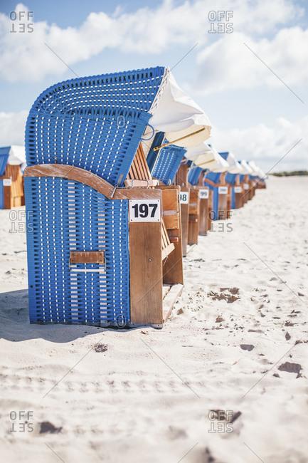 Hooded beach chairs on the beach, Warnemuende