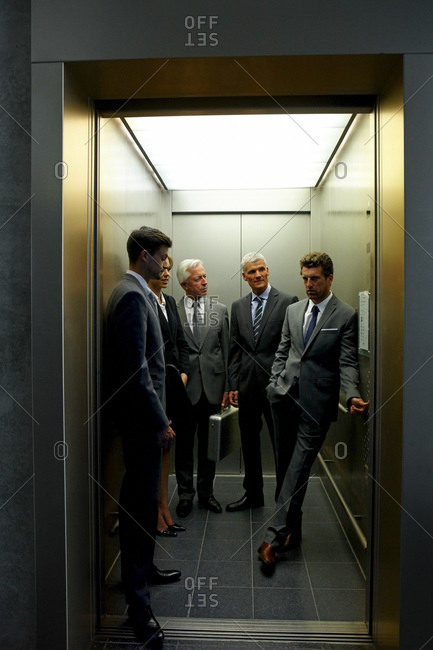Group of businesspeople in an elevator
