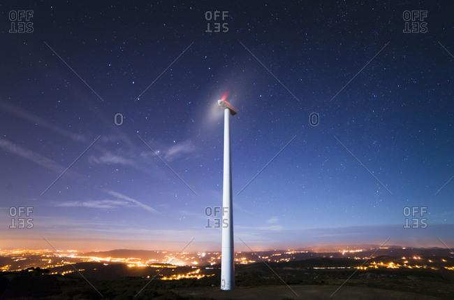 Wind turbine under starry sky, Ferrol
