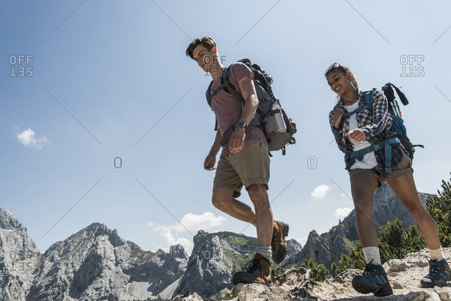 Young couple hiking on mountain trail, Tannheimer Tal