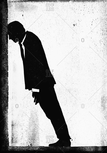 Businessman hitting his head against the wall