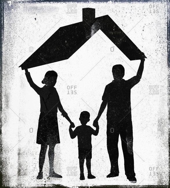 Parents with son standing under a roof