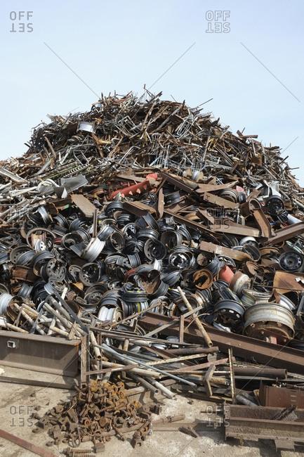 Heap of car parts in scrap yard