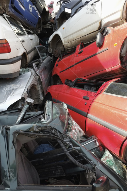 Full frame shot of cars stacked in scrap yard