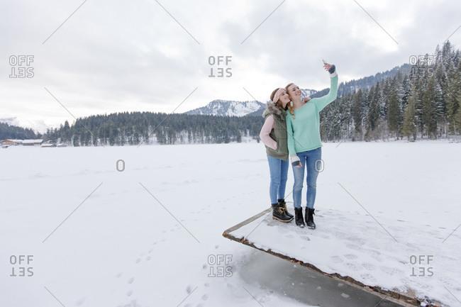 Young women taking a selfie in winter