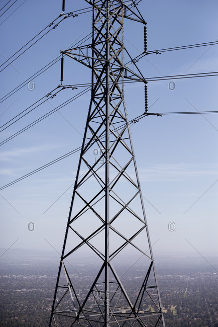 Transmission tower above a city
