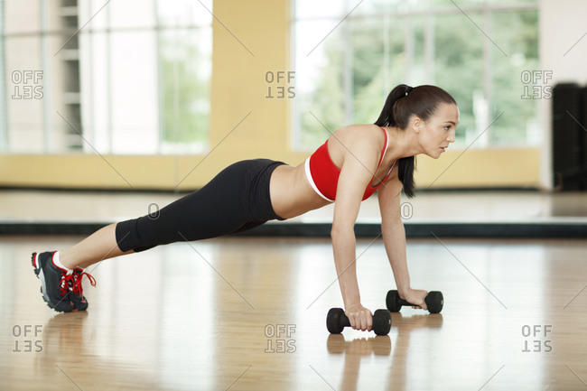 Woman lifting herself during a push up