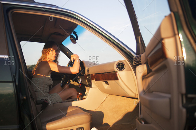 Woman sitting in the driver's seat of a vehicle