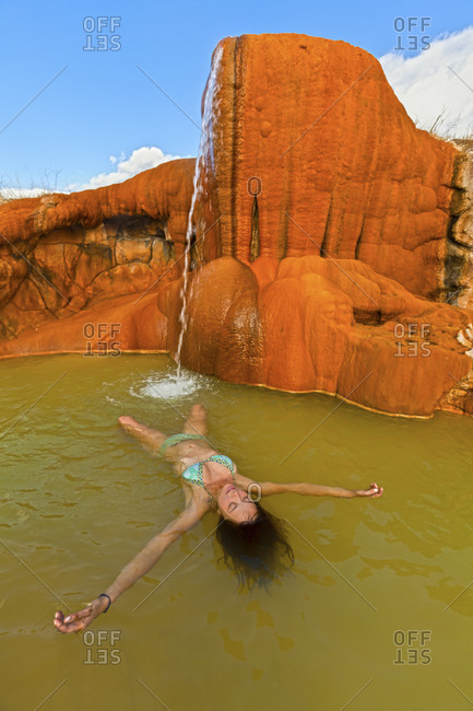 Woman floating in a desert hot spring