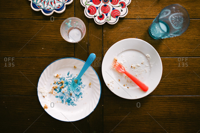 Two empty cake plates