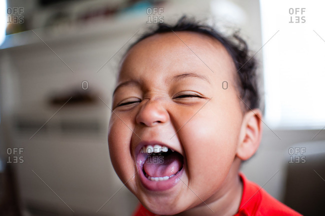 Portrait of boy laughing with glee