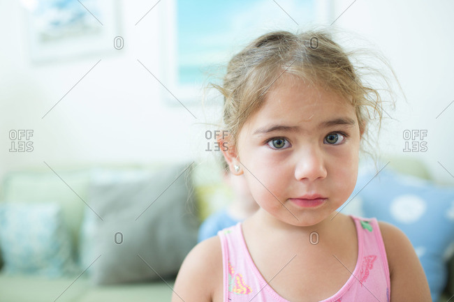 A little girl looks concerned
