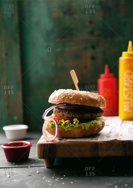A vegan burger with a toothpick