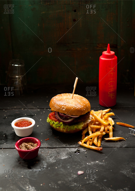 A vegan burger served with french fries and ketchup
