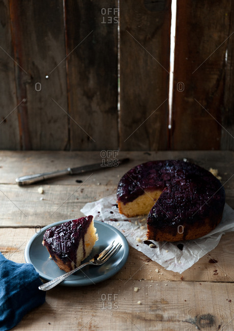 An upside-down blueberry cake served on a blue plate