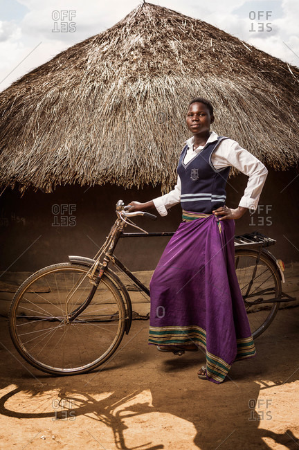 Paicho, Uganda - February 27, 2015: Young woman with a bicycle