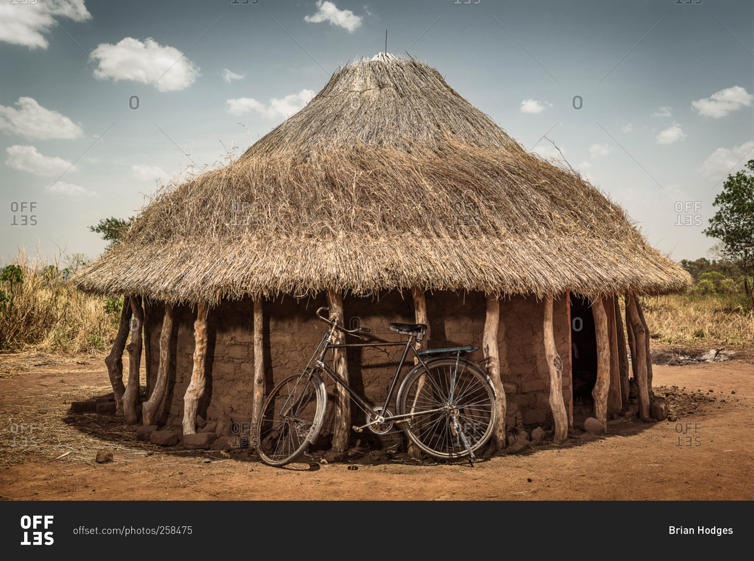 Bicycle Leaning Against A Round Hut