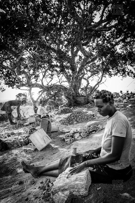 Omel, Uganda - March 3, 2015: Women working in a rock quarry