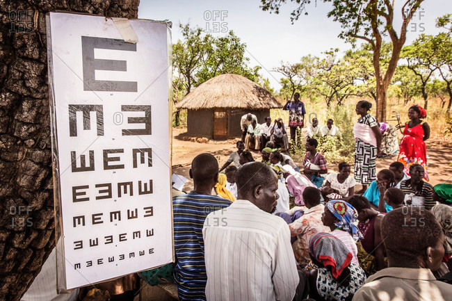Paicho, Uganda - March 4, 2015: Group of people attending an eye clinic in Uganda