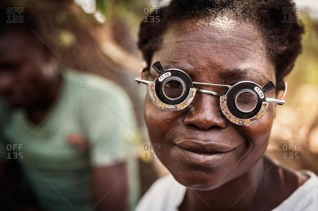 Paicho, Uganda - March 4, 2015: Woman wearing eye examination glasses at a clinic in Uganda