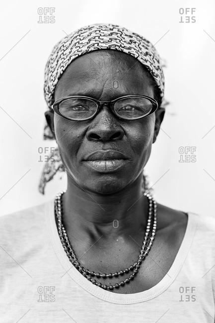 Paicho, Uganda - March 4, 2015: Portrait of a Ugandan woman wearing glasses