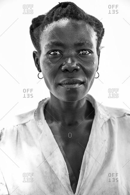 Paicho, Uganda - March 5, 2015: Portrait of a Ugandan woman wearing a collared shirt