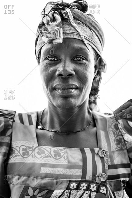 Paicho, Uganda - March 5, 2015: Portrait of a Ugandan woman in a dress and head wrap