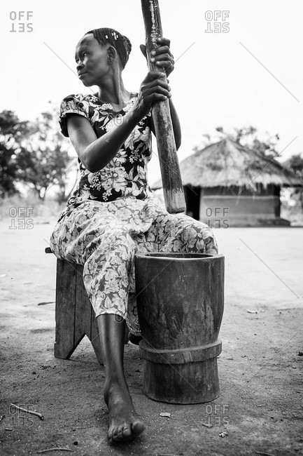 Paicho, Uganda - March 5, 2015: Woman working with a mortar and pestle