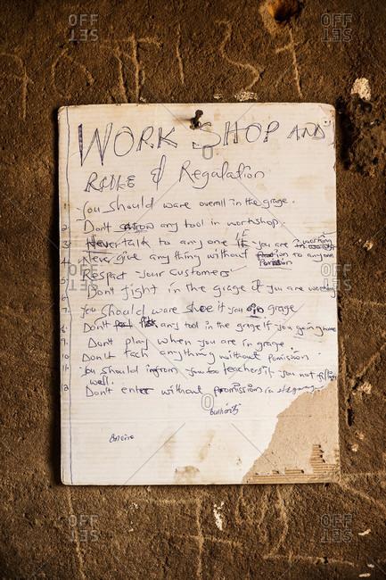 Handwritten rules and regulations for a Ugandan workshop