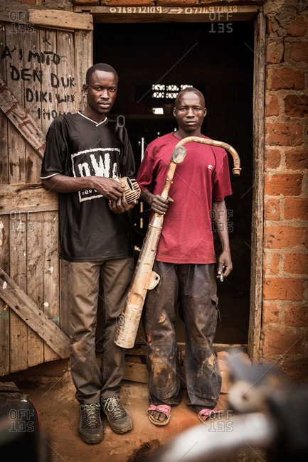 Paicho, Uganda - March 5, 2015: Student and teacher at a workshop in Uganda