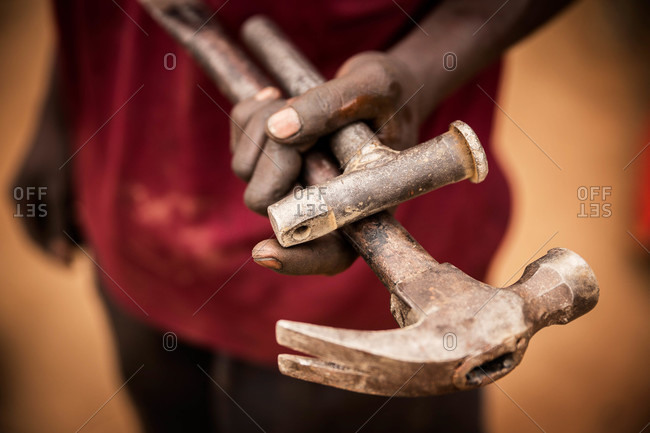 Man holding tools in his hand