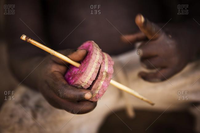 Man holding sponges on a stick