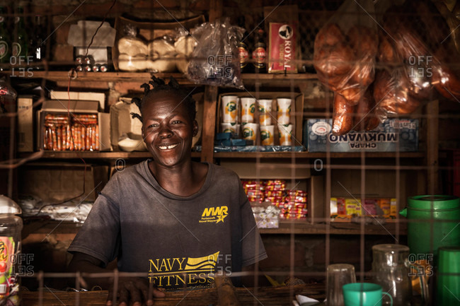 Lacor, Uganda - March 6, 2015: Shop owner standing behind the counter in her store