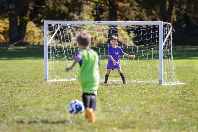 Young goalie stands ready to block the incoming shot