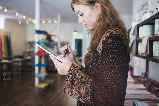 Salesperson using tablet in boutique