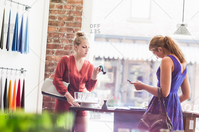 Two women shopping together in a boutique