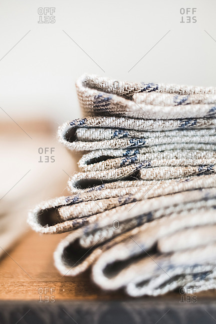 Close-up of a folded stack of linens on table